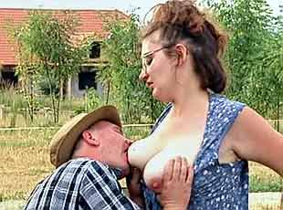3 clips! The buxom farmgirl begins by sucking off the farmhand and gets a shot of piss all over her tits
