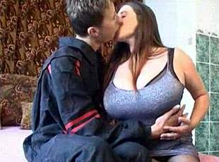 Hot babe with huge boobs fucked by a young boy!