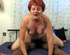 This granny is not typical. She likes black cock and she`s pleasuring her pussy with a vibrator when the scene begins. She`s waiting for her ebony lover to arrive and fuck her with his monster cock. That`s the second half of the hot video.